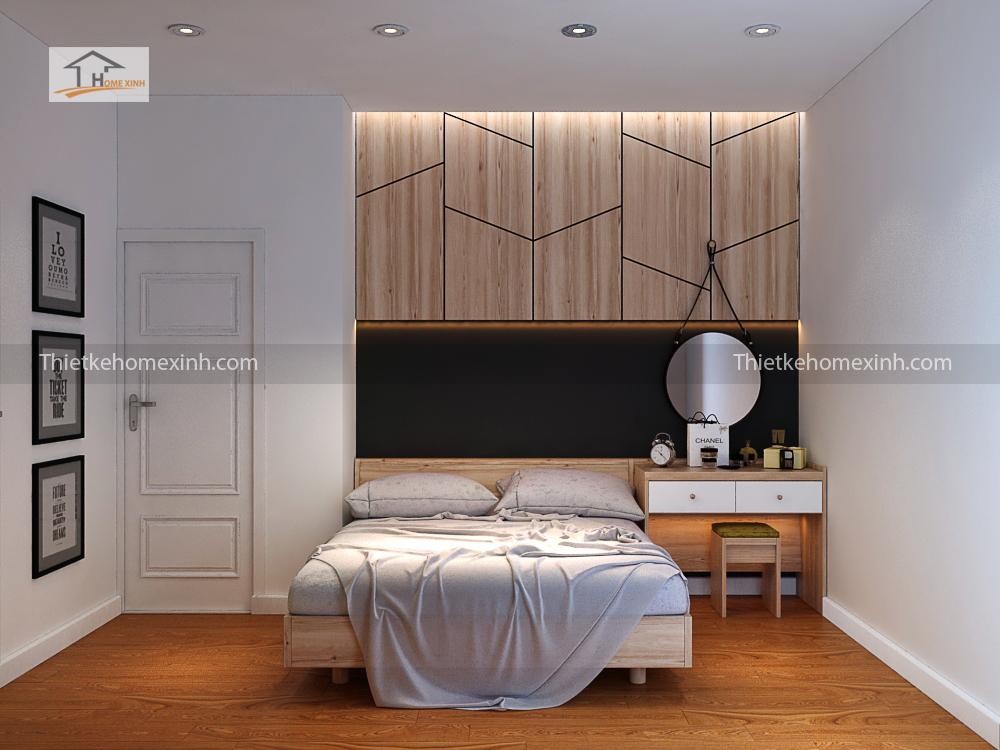 Giường ngủ được thiết kế ở giữa trung tâm phòng, bên cạnh là bàn trang điểm gọn gàng.