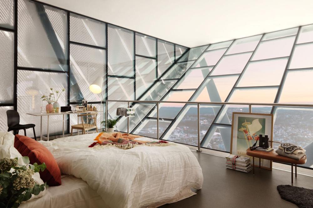 25. Căn phòng ngủ nằm trên lóc tòa nhà cao tầng