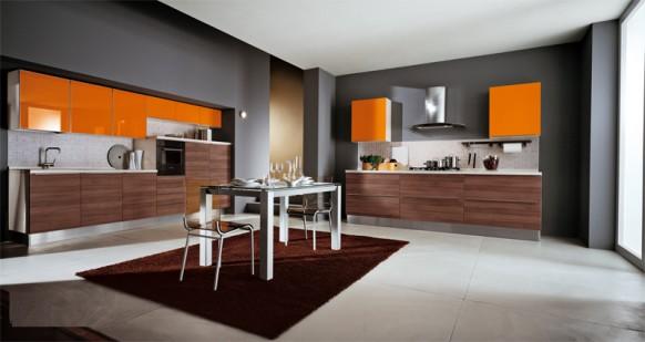 9. Tủ bếp với cục dưới được thiết kế với tông màu nâu vân gỗ, cục bếp trên là điểm nhấn với màu cam tươi đẹp