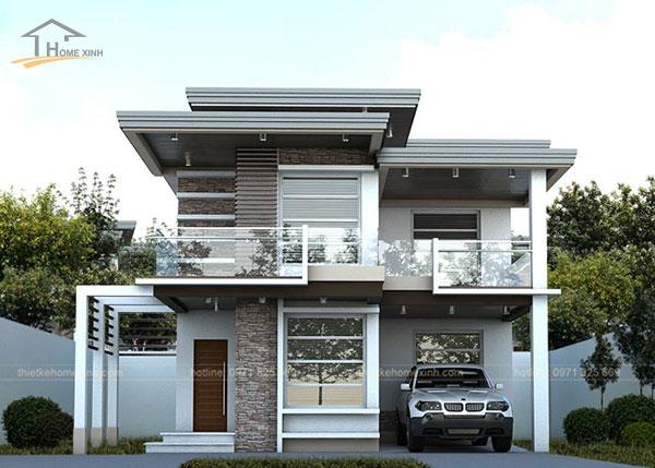 Gara ôtô được bố trí bên hông nhà song song với cửa chính của biệt thự mini 2 tầng đẹp